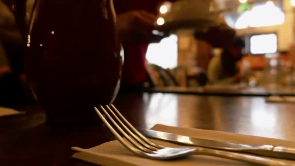 Dinner in a restaurant. Group of people eating and talking. Gourmet food. Knife and fork in the front