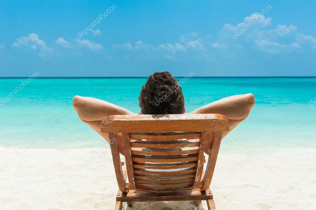 Man resting on beach