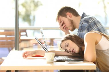Tired students surrendering to fatigue