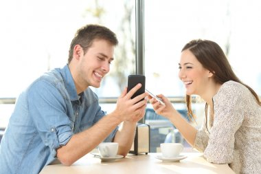 Couple sharing media content with smart phones