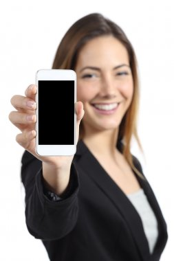 Business woman smiling showing a blank smart phone screen