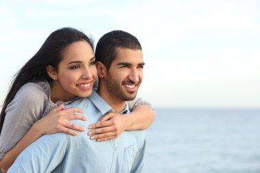 Arab couple flirting in love on the beach