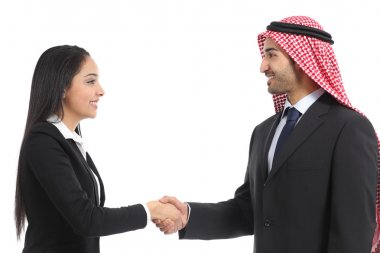 Side view of an arab saudi businesspeople handshaking