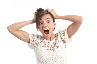 Front view of a scared woman screaming with hands on head