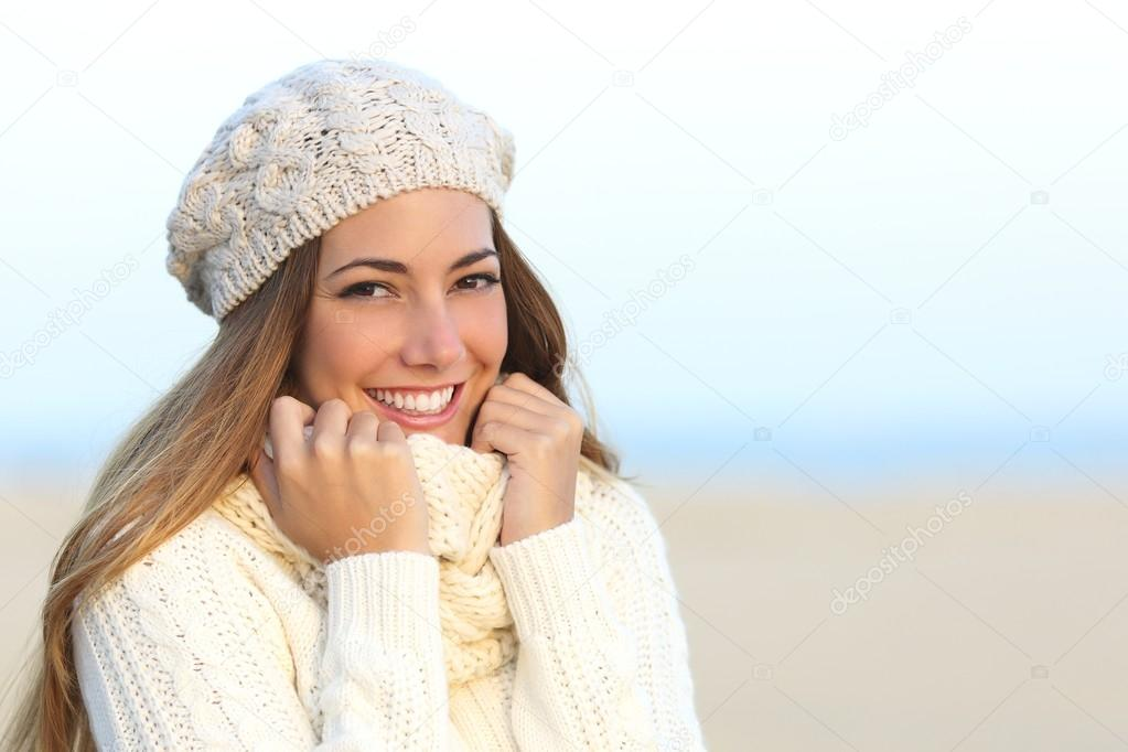 Woman smile with a perfect white teeth in winter