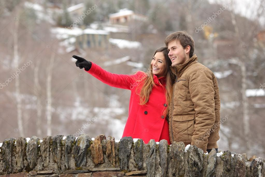 Couple crossing a bridge in winter holidays
