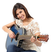 Fotografie Musician woman playing guitar in a course