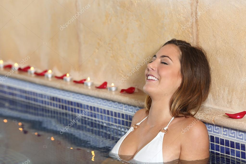 Woman relaxing happy in a spa jacuzzi