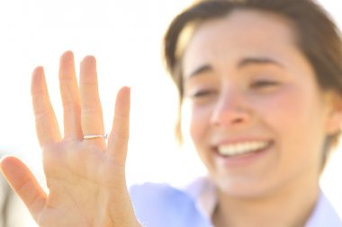 Woman looking an engagement ring after proposal