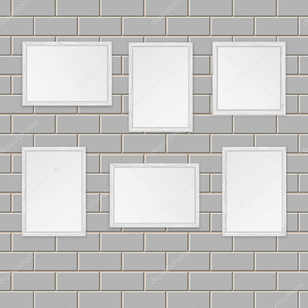 Art gallery.Set of wooden frames on the wall of white bricks — Stock ...