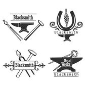 Set of vintage monochrome blacksmith labels and design elements.