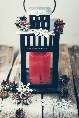 Christmas Lantern with Red Candle on Wooden Table