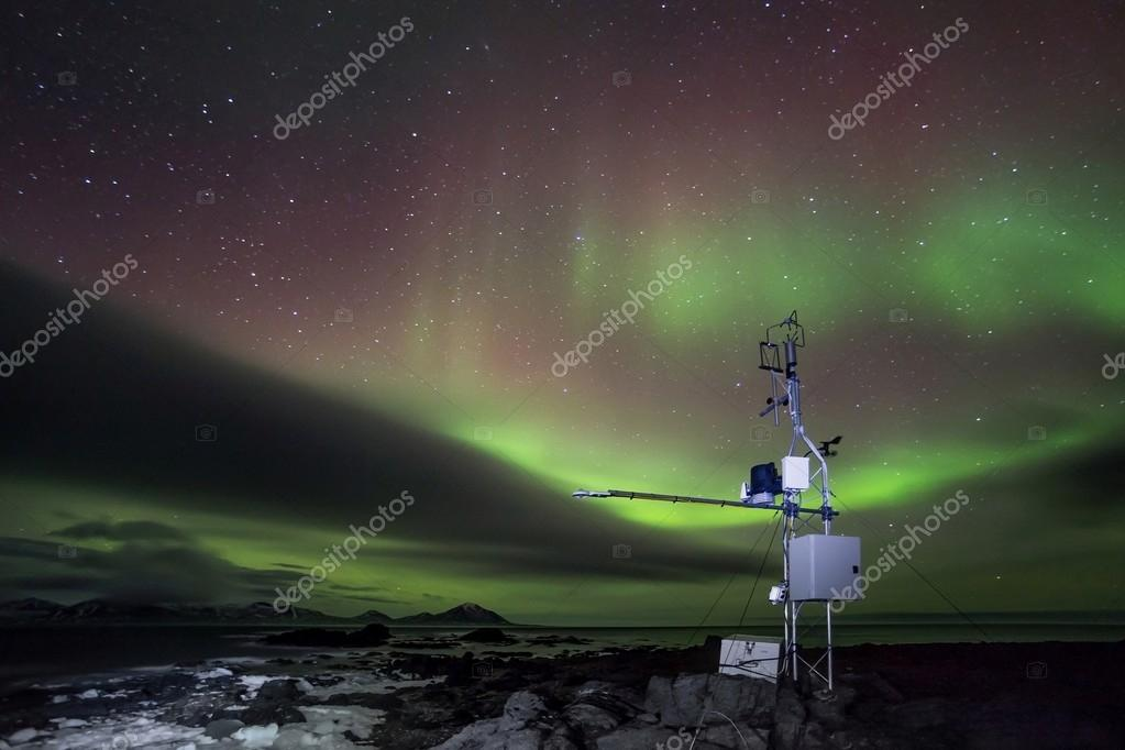Automated remote meteorological station in the Arctic - northern lights
