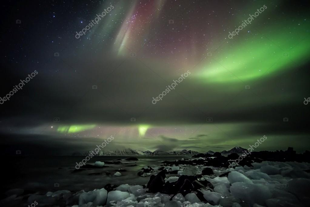 Northern lights over the frozen Arctic fjord