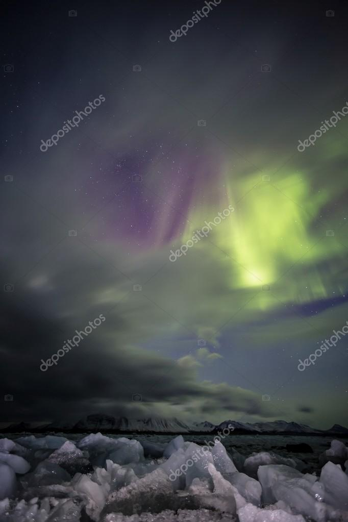 Natural phenomenon of Northern Lights (Aurora Borealis) - vertical photo
