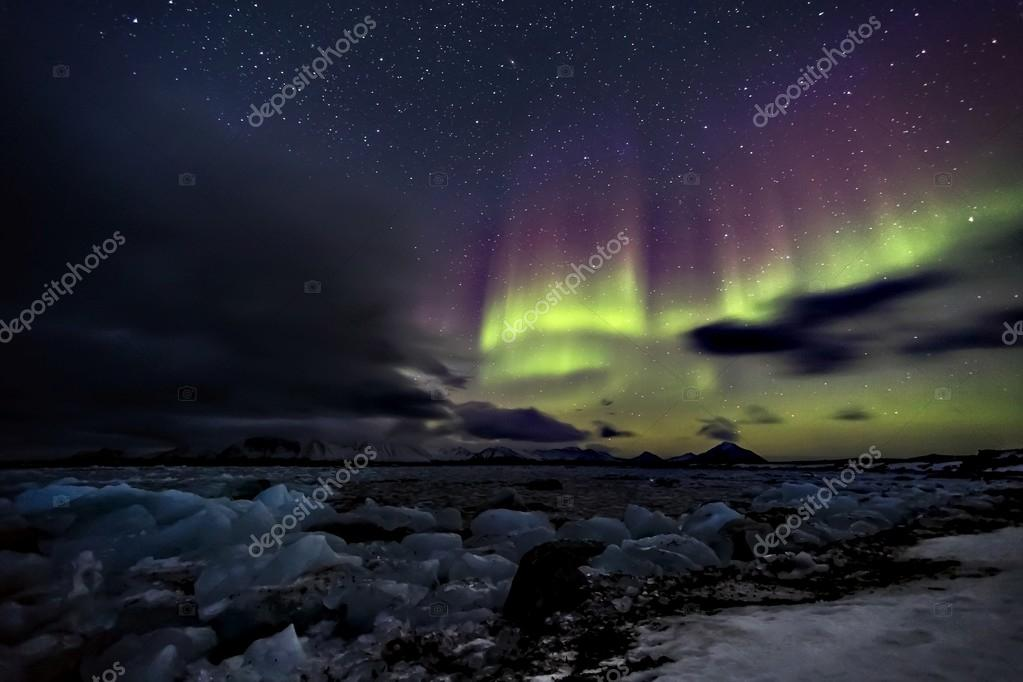 Natural phenomenon of Northern Lights (Aurora Borealis) related to the earth's magnetic field, ionosphere and solar activity. Solar storm.