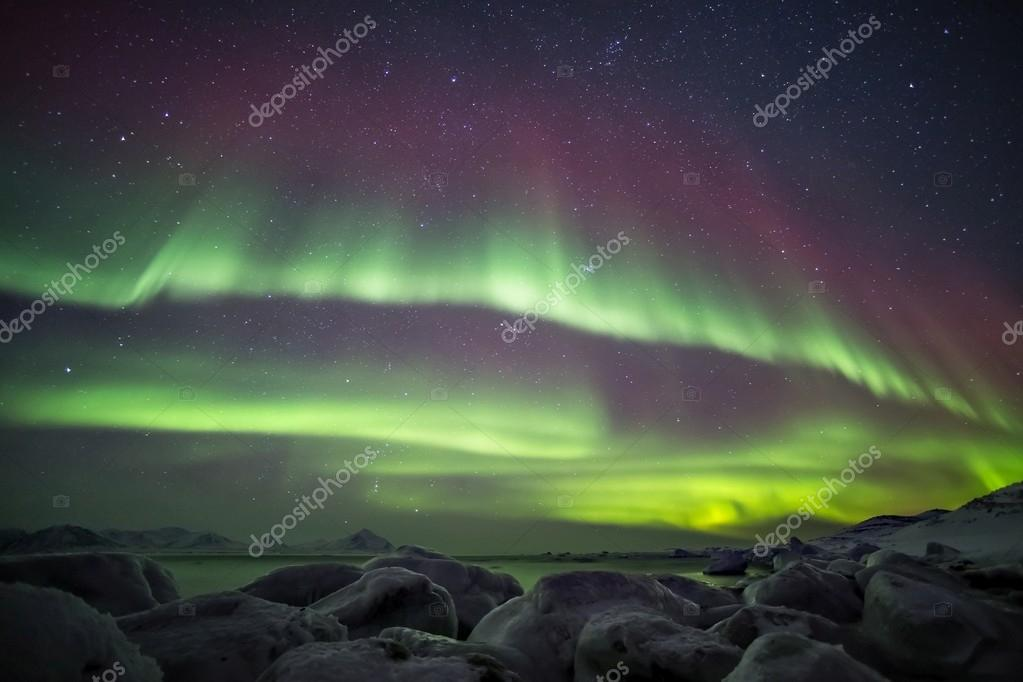 Unusual, colorful Northern Lights above the Svalbard Archipelago - Arctic