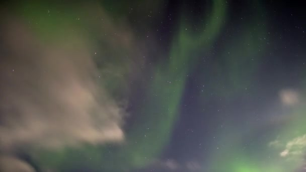 Beautiful Northern Lights over the Arctic mountains and glaciers