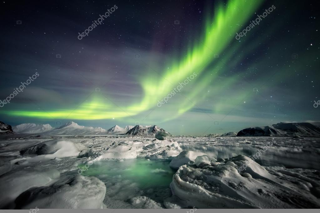 Unusual Arctic winter landscape - Frozen fjord & Northern Lights