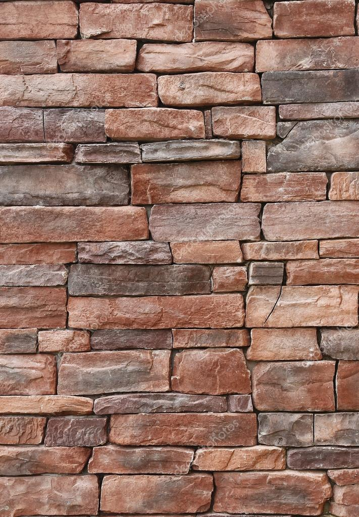 Pattern of old red stone Wall