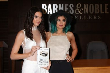 Kendall Jenner and Kylie Jenner sign the book