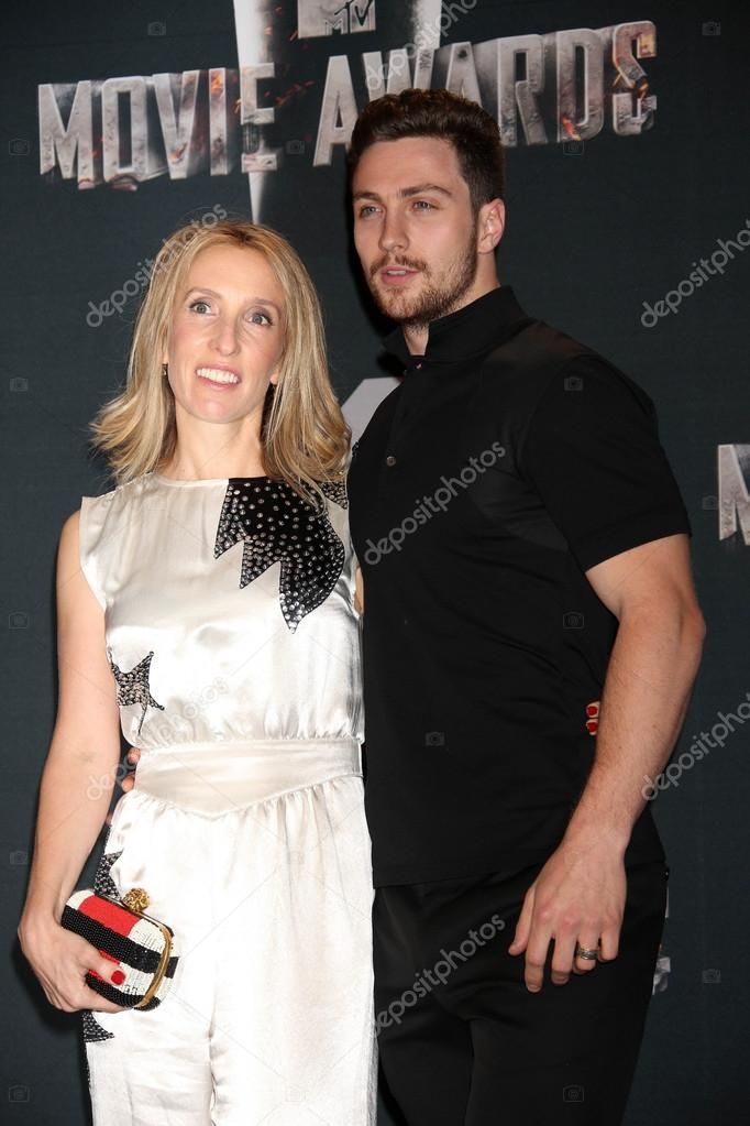 5c1db167c074e Sam Taylor-Wood and Aaron Taylor-Johnson at the 2014 MTV Movie Awards on  April 13, 2014 in Los Angeles, CA. — Photo by s_bukley