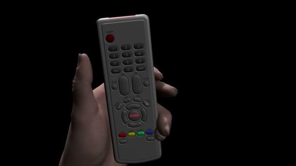 Mano maschio caucasico che tiene un telecomando premendo un pulsante contrassegnato invio