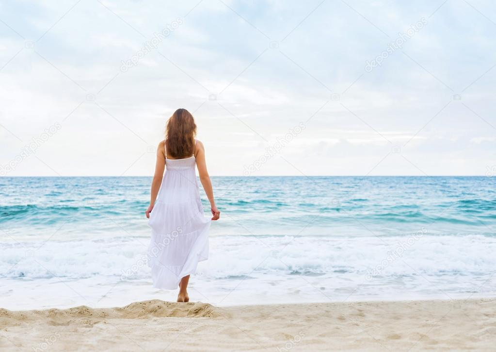 woman in a white dress on the beach