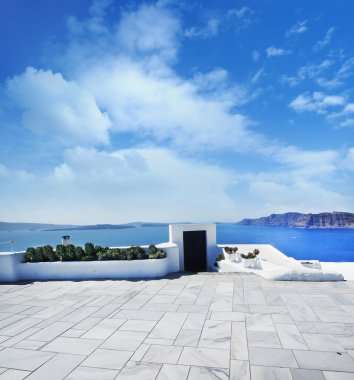 Terrace on Santorin island with a view on azure Mediterranean se