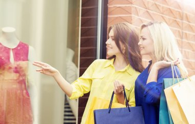 Attractive girls walking in city center