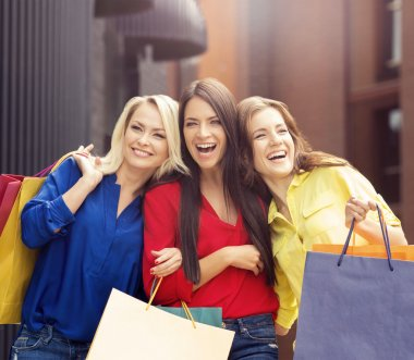 Pretty women with shopping bags