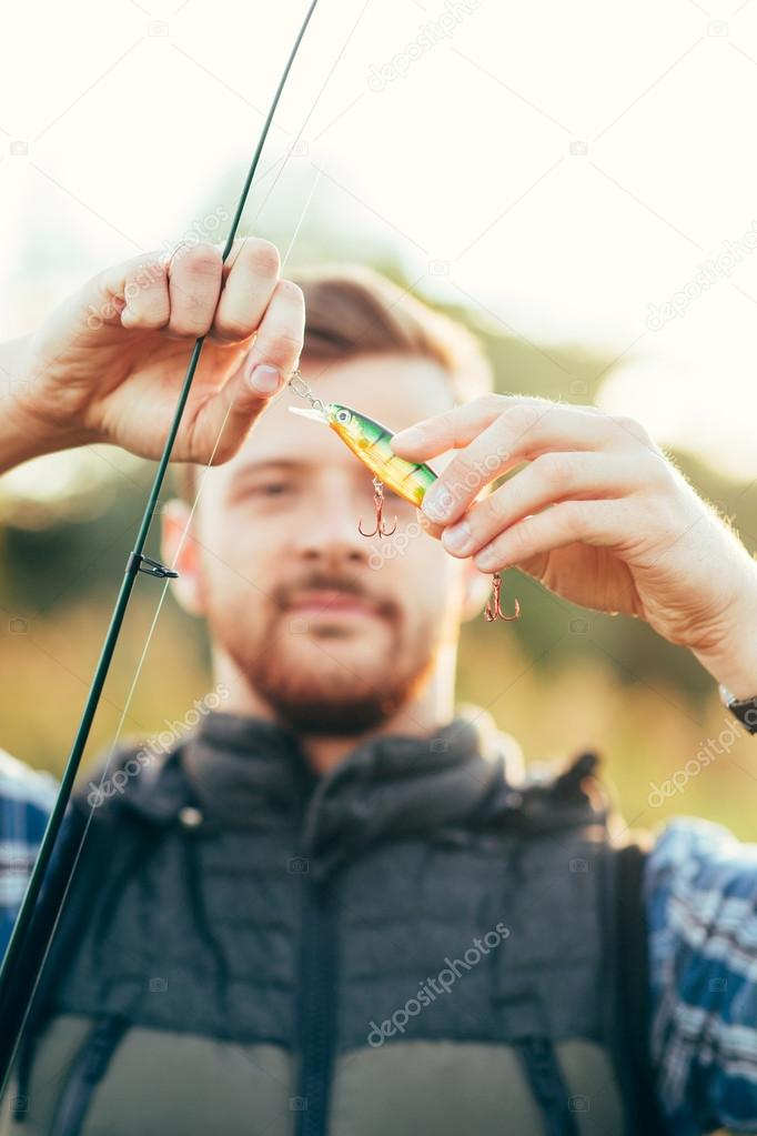 Fisherman with spinning rod
