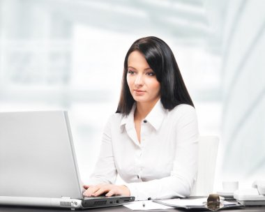 Young and attractive business woman working