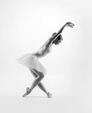 Young female ballet dancer performing a move
