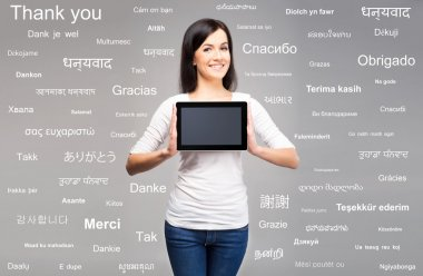 Young brunette woman holding a tablet
