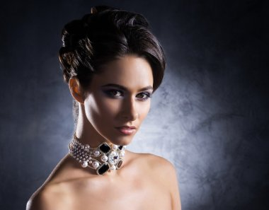 Woman in jewels of platinum and stones
