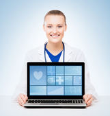 Fotografie Professional medical doctor with laptop