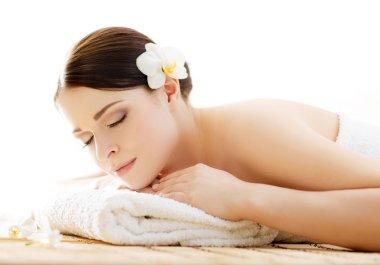 Woman in spa massage procedure