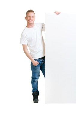 teenager boy holding blank banner