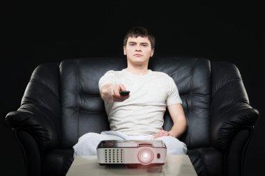 Man watching sport broadcast