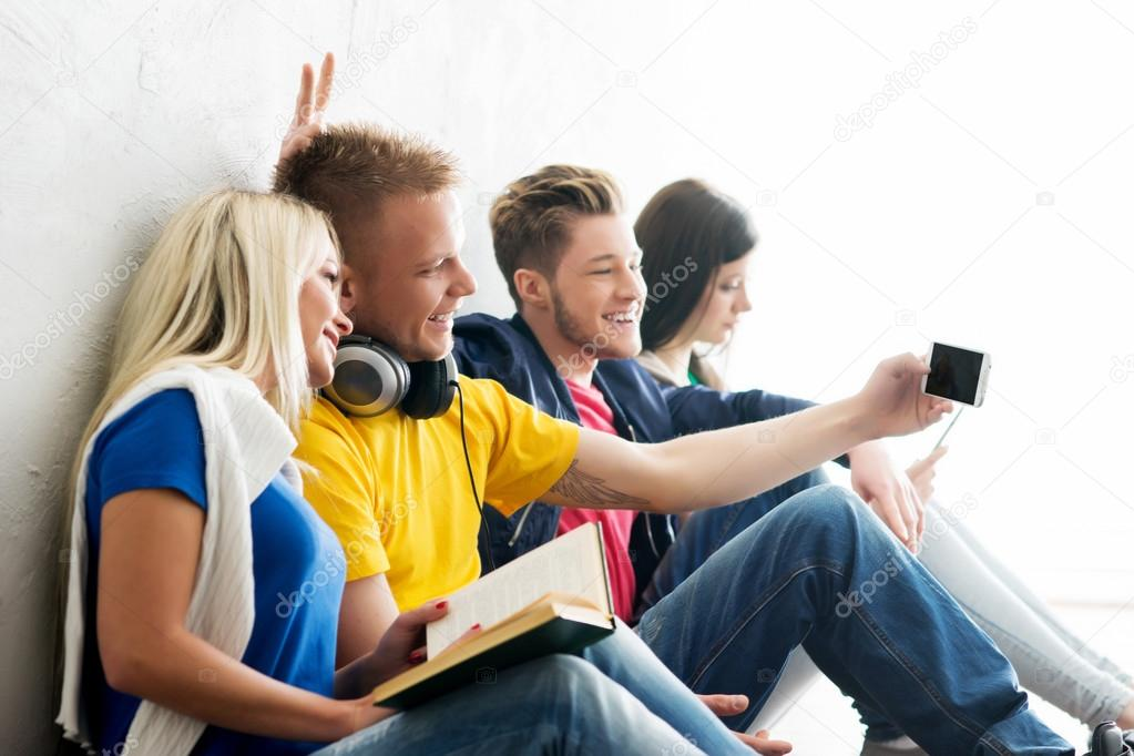 students  taking selfie on smartphone