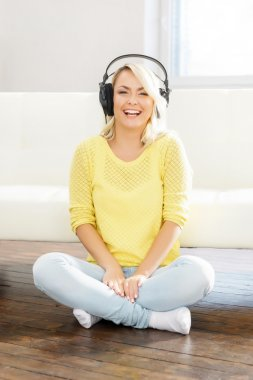 woman listening to the music at home