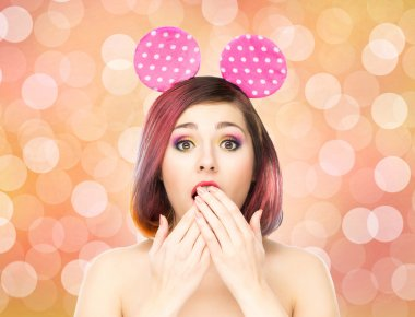 woman in mickey mouse ears