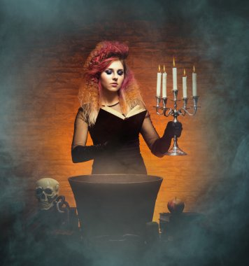 witch casting spell using a magical book