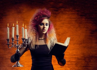 witch casting spell using magical book
