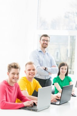 Teacher and students at programming lesson