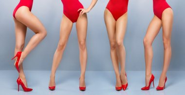 Beautiful legs of  women in red swimsuits
