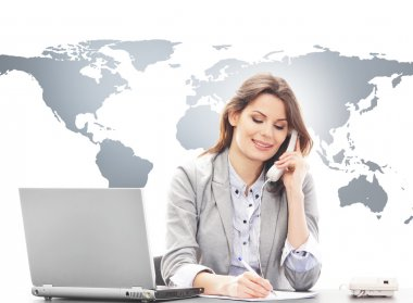 Beautiful business woman answering international calls