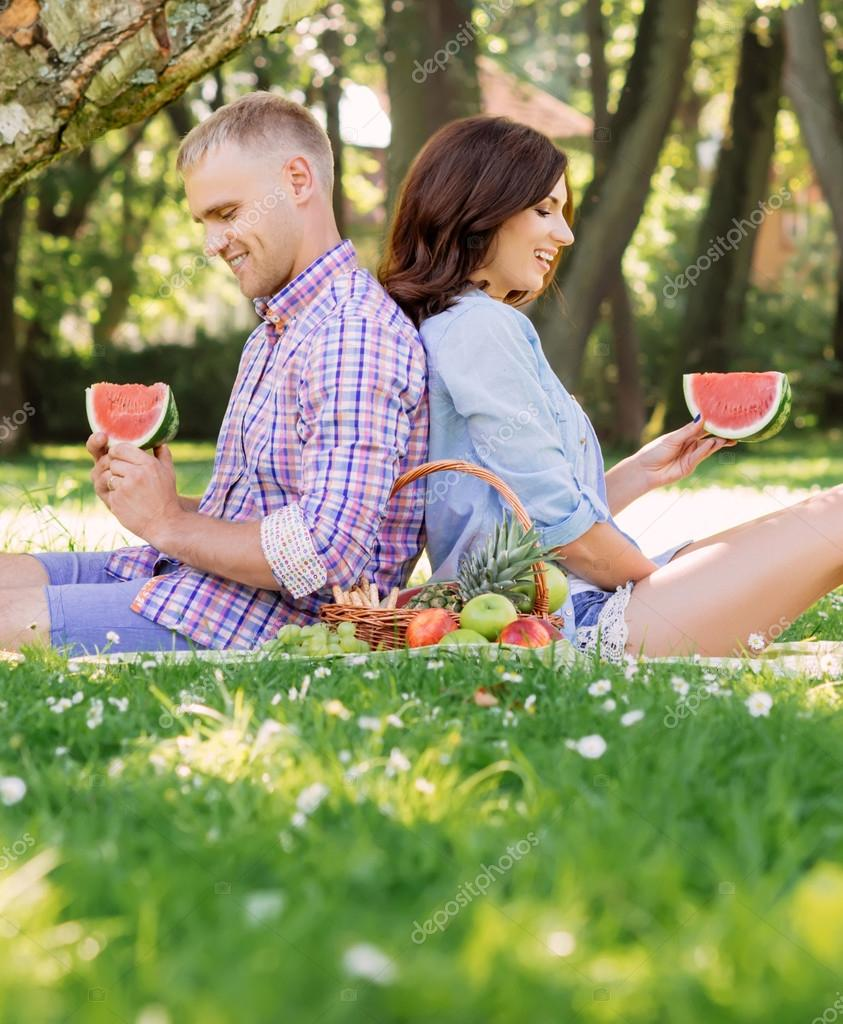 Happy couple relaxing on a picnic
