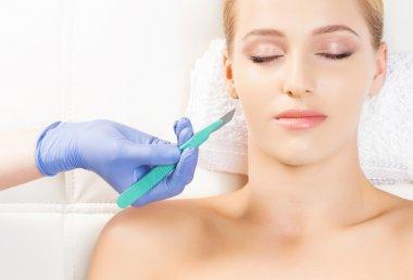 Beautiful woman getting face lifting operation